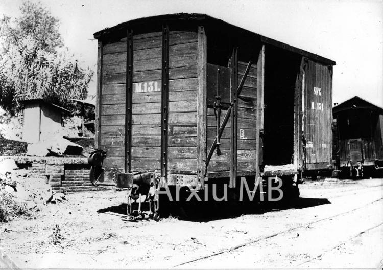 30.11.-0001 El tren de Sant Feliu. Vagó de càrrega  -  Miquel Bibià